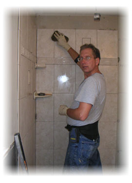 Frank Arch installing a ceramic shower.