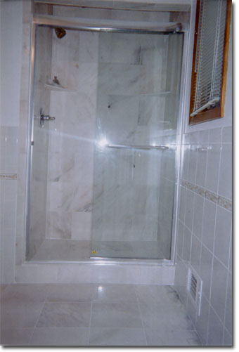 Convert tub area to large 5 ft tiled shower